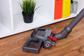 Hoovering a parquet Royalty Free Stock Photo