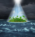 Hope and aspirations success concept with a dark storm ocean background contrasted with a glowing light from above shinning down Stock Images