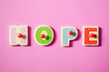 Hope color wooden text in word on pink background Stock Image