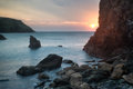 Hope cove sunset landscape seascape with rocky coastline and lon of at in england Stock Photo