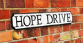Hope drive sign against old red brick background Royalty Free Stock Image