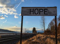 Hope sign with blue sky railroad tracks and a pastoral scene Stock Photo