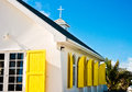 Hope town church white building with bright yellow window shudders in abaco bahamas Royalty Free Stock Photography