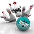 Hope vs despair bowling bowl faith conquers doubt ball strikes pins with word to illustrate conquering with strong in yourself or Royalty Free Stock Photo