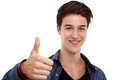 Hopeful young man looking ahead and doing ok gesture Royalty Free Stock Photography