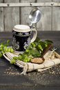 Hops and malt seeds and spikes traditional beer jug on cloth napkin Stock Photos