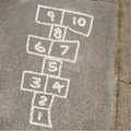 Hopscotch game in chalk on sidewalk kids of drawn Stock Photo