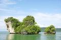 Horizon view of a big horizontal rock cliff with green vegetation, Krabi Thailand. Royalty Free Stock Photo