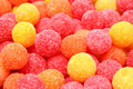 Horizontal background made of multi-coloured sweets Stock Photos
