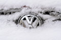 Horizontal front view of Volkswagen logo covered in snow Royalty Free Stock Photo