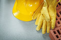 Horizontal image of red bricks hard hat safety gloves on concret Royalty Free Stock Photo