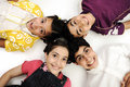 Horizontal  photo of four children group,  smiling Royalty Free Stock Photography