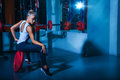 Horizontal photo of pretty sports woman in gym she looking away Royalty Free Stock Photo