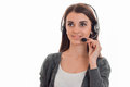 Horizontal portrait of young beautiful call office worker girl with headphones and microphone isolated on white Royalty Free Stock Photo