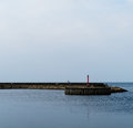Horizontal simple Danish quay with lighthouse Royalty Free Stock Photo
