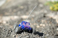 Horizontal of toy rc truck on dirt mound in the sun Royalty Free Stock Images