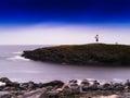 Horizontal vivid Norway lighthouse in ocean bay Royalty Free Stock Photo