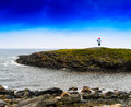Horizontal vivid Norway right aligned lighthouse  on island land Royalty Free Stock Photo