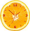 Horloge orange de tranche Photographie stock