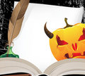 Horned Jack o Lantern and open ancient book Royalty Free Stock Photo