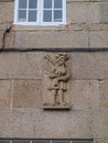 Hornpipe player bas relief in a pontevedra house Royalty Free Stock Images