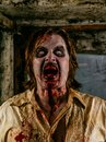 Horrible hungry zombie photo of a covered with blood about to attack you Stock Photo
