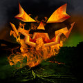 Horror scene scary jack o lantern pumkin face an and twisted dead tree roots burning inferno hell fire in the evil green fog of a Royalty Free Stock Photography