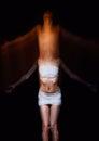Horror shot: soul is leaving body of woman. Blurry effect
