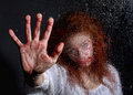 Horror themed image with bleeding freightened woman in situation bloody face Royalty Free Stock Photo