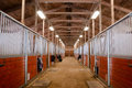 Horse barn animal sport paddock equestrian ranch racing stable the center path through a Royalty Free Stock Photography