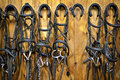 Horse bridles hanging in stable Stock Image