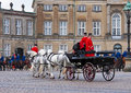 Horse carriage during the guards changing ceremony daily of royal at noon time in front of amalienborg palace in copenhagen Royalty Free Stock Images