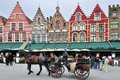 Horse carriage on the main square grote markt in brugge belgium Stock Image