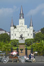Horse Carriage and tourists in front of Andrew Jackson Statue & St. Louis Cathedral, Jackson Square in New Orleans, Louisiana Royalty Free Stock Photo