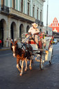 Horse drawn carriage mexico driver on tourist pulled by paint Royalty Free Stock Image