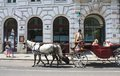Horse drawn carriage vienna austria with tourists on the streets of Stock Image