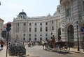 Horse drawn carriage vienna hofburg austria with tourists on the streets of imperial palace Royalty Free Stock Photos
