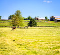Horse farm scenic image of a with stables and pasture Stock Images