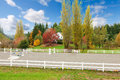 Horse farm with white fence and fall colorful leaves northwest rach changing Royalty Free Stock Photo