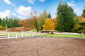 Horse farm with white fence and fall colorful leaves northwest rach changing Stock Images