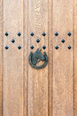 Horse head and shoe a s on a wooden door with metal studs above Stock Images