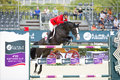 Horse jumping beat mandli from switzerland a obstacle during furusiyya fei nations cup team consolation competition on Royalty Free Stock Photos