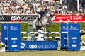 Horse jumping katharina offel from ukraine rides charlie at the th csio event at the real club de polo barcelona on september in Royalty Free Stock Image