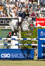 Horse jumping katharina offel from ukraine rides charlie at the th csio event at the real club de polo barcelona on september in Stock Photos
