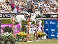 Horse jumping katharina offel from ukraine rides charlie at the th csio event at the real club de polo barcelona on september in Stock Images