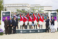 Horse jumping usa team the us national pictured on the winners podium at furusiyya fei nations cup consolation competition on Royalty Free Stock Image