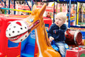 On the horse little boy in amusement park Stock Photography
