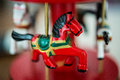 Horse a one red wood in room Royalty Free Stock Photos