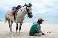 Horse and owner wait for tourists on the hua hin beach thailand Stock Images