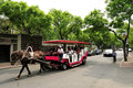 A horse pull a horse drawn on the road group of tourists in vehicle this kind of special vehicles in tianjin china Royalty Free Stock Image